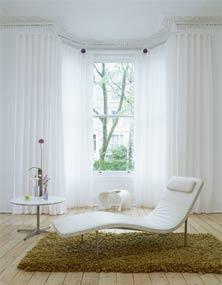 bay window with white curtains